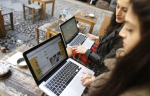 Two Turkish women try to get connected to Twitter with their laptops at a cafe in Istanbul amidst an Internet crackdown in the country in 2014. Should they be considered Internet addicts? (Tolga Bozoglu/EPA)