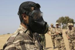 Sgt. Tatum Vayavananda A Royal Moroccan Armed Forces soldier is in a gas mask for a demonstration of Chemical, Biological, Radiological, and Nuclear defense techniques during Exercise African Lion 15 in Tifnit, Morocco, May 16. The Royal Moroccan, U.S., U.K., Netherlands, and Belgian Armed Forces integrated while conducting peacekeeping support training to improve military capabilities and operational familiarity as one international coalition.
